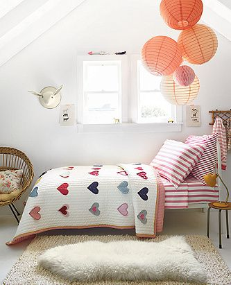 Our hearts are in this sweet and sunny room, where snuggly HannaSoft sheets mix with an amazing reversible quilt of handcrafted hearts. Add an artisan rug that's fluffy underfoot and let the coziness begin…