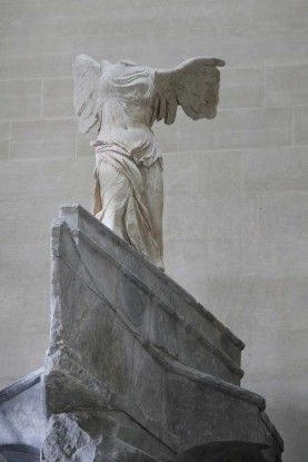 """As if just landing in a fierce headwind, her great wings still aloft, her body twisting slightly as if to maintain its balance, while the sheer chiton, heavy with sea spray, both clinging and billowing dramatically : The Winged Nike of Samothrace, a presence invoking a spirit of celebration and commemorating the """" arête """" (physical and moral excellence) of gods and men"""