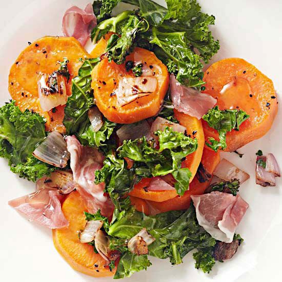 Sweet potatoes get fresh flavor with the help of sauteed kale and shallots. Add a little prosciutto and a drizzle of honey, and you've got yourself one sweet-and-savory side dish./