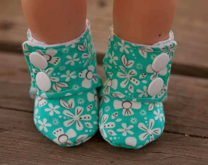 I have one of those babies that hucks shoes. =) I wanted her to have cute boots, but none of them were just going to stay on. I didnt want to gamble on a pattern that might not stay on, so I made my own!  I LOVE the pattern I made and Maggie cant just yank them off. Her first pair was simple grey fleece and we were asked over and over about her booties everywhere we went. So many people encouraged me to make the pattern in more sizes, and get it ready to sell, and I am so thankful - it w...