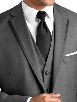 This is the suit you saw at Men's Wearhouse @Jenna Leeds    Black by Vera Wang line for Men.  Satin-edged, grey suit.