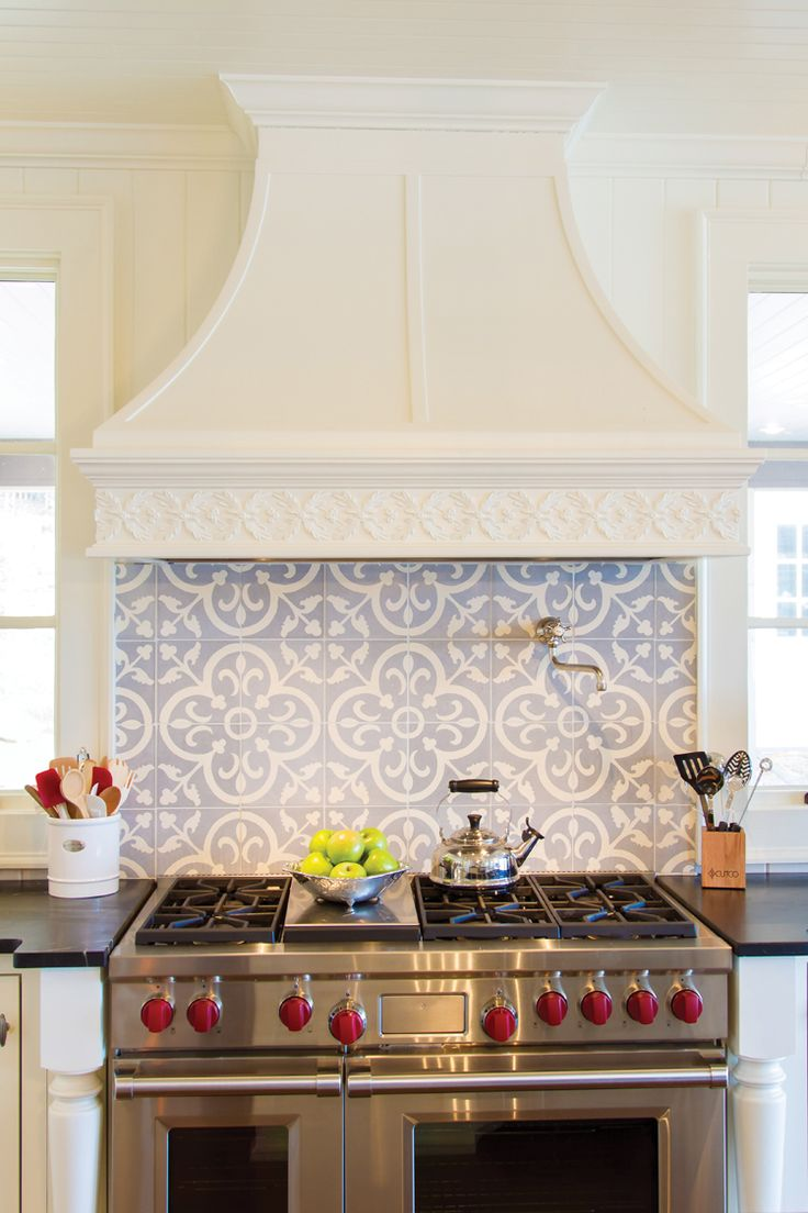 handmade tile backsplash and custom range hood