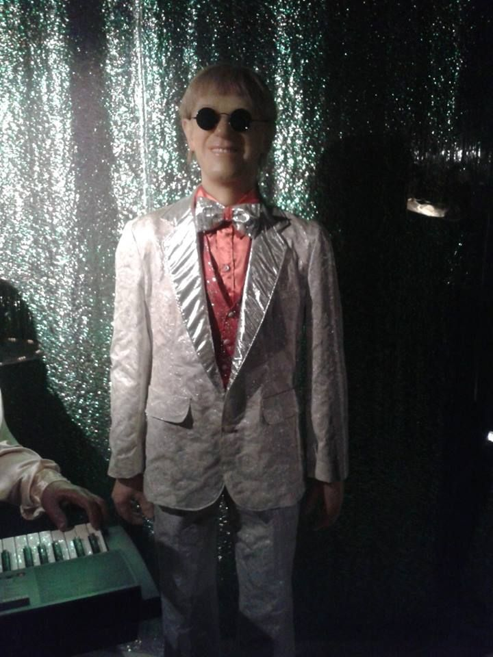 #Sir #Elton #John in a white tux with a pink dress shit and classy black sunglasses, #wax #statue.