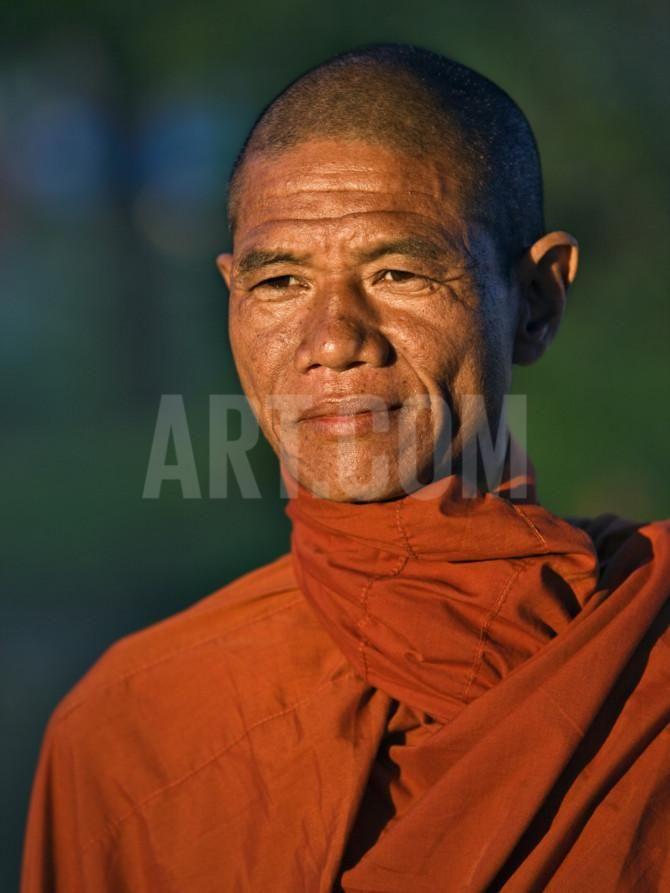 Burma, Rakhine State, A Buddhist Monk Enjoys the Late Afternoon at Sittwe, Myanmar Photographic Print by Nigel Pavitt at Art.com