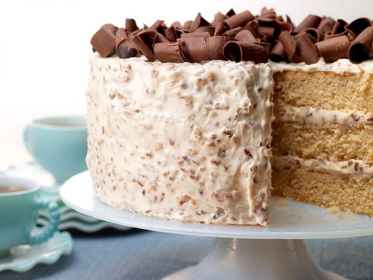 Southern Praline Cake - It doesn't get more Southern than this. This sweet and moist layer cake is topped with decadent pecan buttercream frosting.