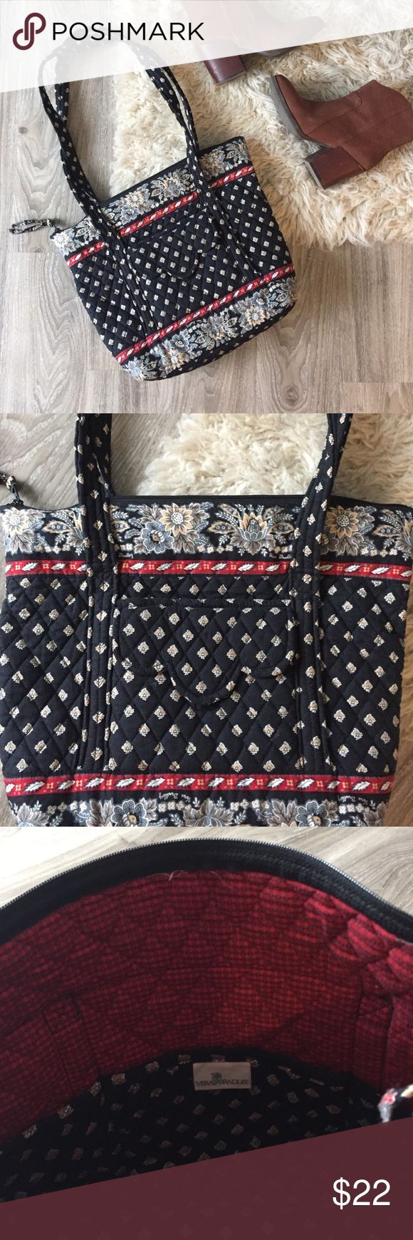 Vera Bradley Tote Bag Adorable Very Bradley tote bag in a classic black pattern that retired in 2005. Inside and outside pockets, super functional! Shown next to a wine bottle for size reference (please note, it can tote wine 🍷 😊). No flaws! Vera Bradley Bags