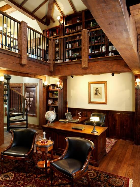 Massive home office with spiral staircase up to library it or