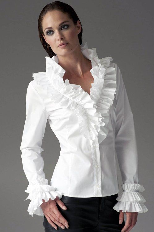 https://www.cityblis.com/6074/item/12542 | FILADELFIA WHITE - $160 by The Shirt Company | This flamboyant best selling shirt with gathering at the collar and cuffs is back by popular demand. Its fitted silhouette and layered ruffles are sure to get you noticed. Shirt with layered frill collar and cuff Body length: Sizes 8 - 12: 63.5-64.5 cm, Sizes14 – 18: 65-66 cm Italian fabr... | #Tops/Blouses