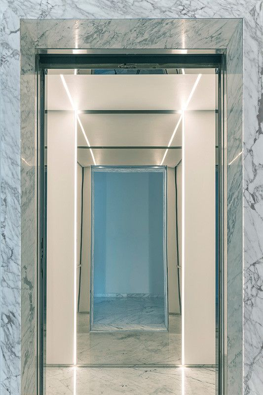 LEVELe-105 Elevator Interior with customized panel layout; Minimal panels in Bonded Quartz, White with custom pattern, Stainless Steel with Mirror finish; Round handrail; custom ceiling in Bonded Quartz, White at Yoo Pune, Pune, Maharashtra, India