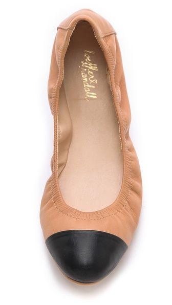 Cap toe ballet flats.