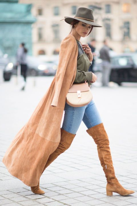 11 March Alessandra Ambrosio looked every inch the supermodel while out and about in Paris wearing thigh-high boots and a long coat.