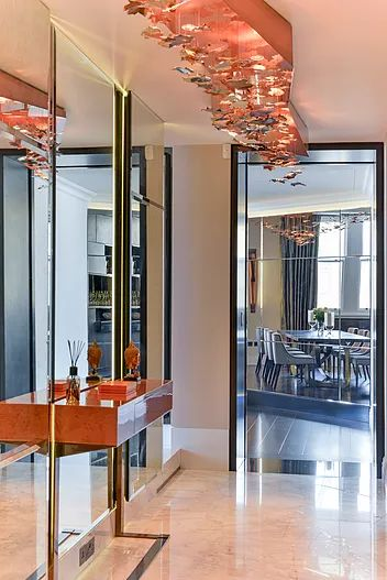Bronze gold and copper bespoke design chandelier by Macassar Properties - London investment and development company