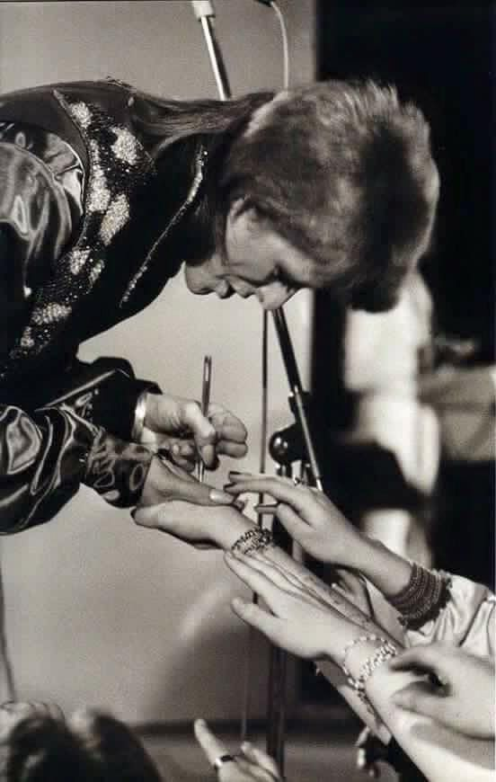 David Bowie signing autographs in his early days