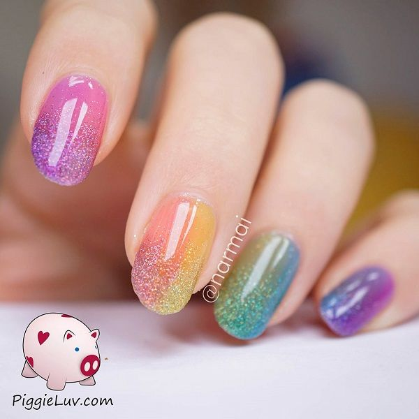 Fantastic and colorful Ombre glitter nail art. Put together your favorite colors into beautiful Ombre combinations and don't forget to add sprinkled of glitter on top for effect.