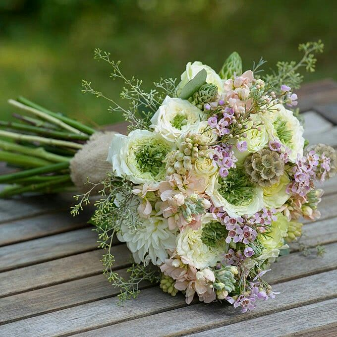 Rustic Hand Tied Wedding Bouquet Featuring: White Dahlias, White/Green Italian Ranunculus, Peach Stock, Lavender Waxflower, Star Of Bethlehem, Tuberose Buds, Green Seeded Eucalyptus