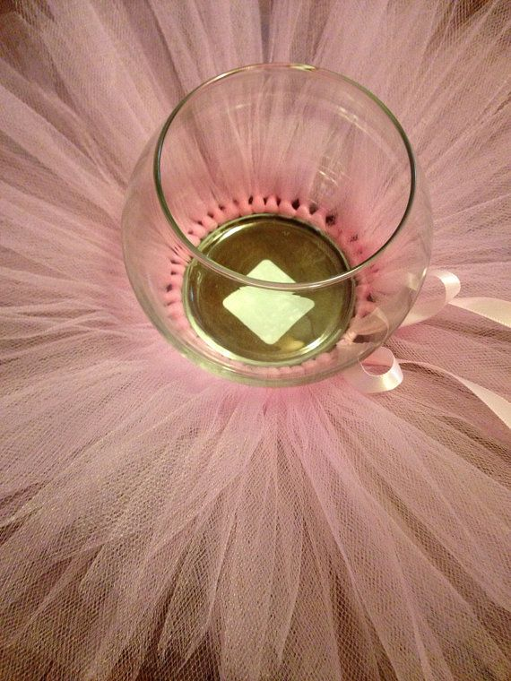 Delicate handcrafted tutu centerpiece made out of tulle and ribbon. Glass vase NOT INCLUDED. Choose your favorite colors.    I can make matching invitations, banners, cupcake topper, you name it! Send me a message or email me at mironwendy@gmail.com