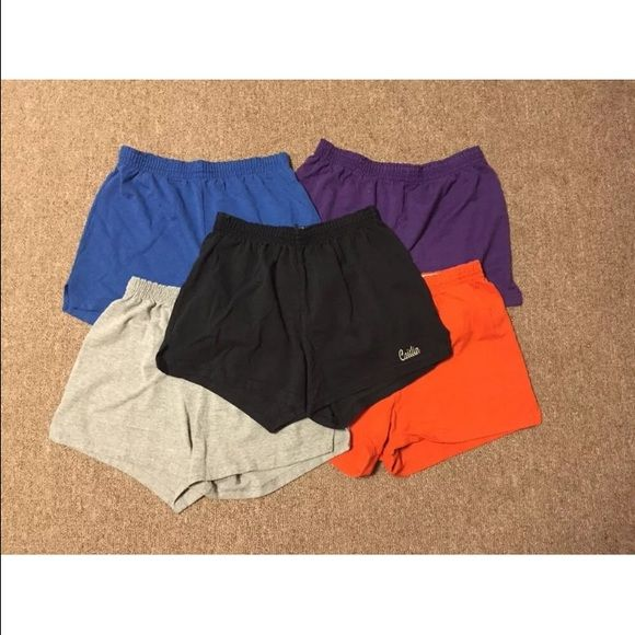 "Soffe Cheer Shorts | M Got these soffee shorts for cheerleading and wore them for about several years to practice, camp, etc... Two pairs: the black and blue, have my name ""Caitlin"" on them. Three pairs: the black orange and blue, all have no tag but the other two colors do. I can guarentee they're all size medium. Still soft and durable! They've held up all these years! I haven't worn them in the past two years though.  NO TRADES  NO PAYPAL  SMOKE FREE HOME  CATS LIVE HERE Soffe Other"