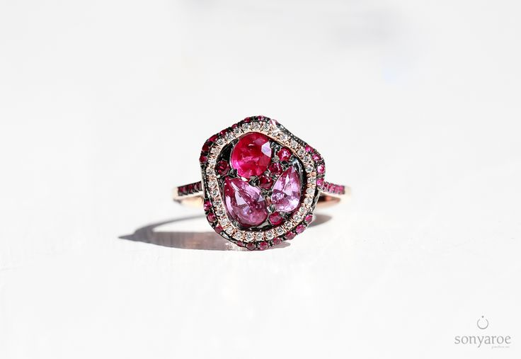 The Queen of right-hand rings.. An organic shaped Ruby + Pink Sapphire Ring with Diamonds finished in 18k Rose Gold from SRJ!