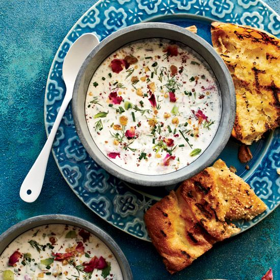 Chilled Persian Yogurt Soup   Filled with herbs, nuts and raisins, the soup is delicious with grilled bread.