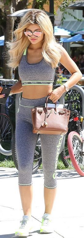 Kylie Jenner: Bracelet – Cartier  purse – Hermes  Shirt and pants – Superdry  Sunglasses – Dior