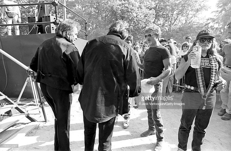 American country music group the Highwaymen, from left, Johnny Cash (1932 - 2003), Waylon Jennings (back to camera), Kris Kristofferson, and Willie Nelson backstage at Central Park SummerStage, New York, New York, May 23, 1993.