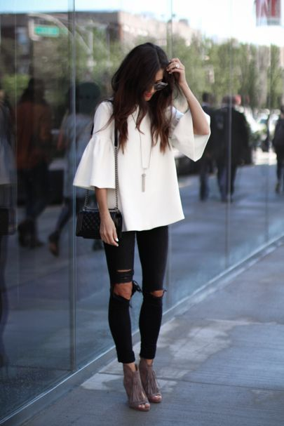 white ruffle sleeve + ripped black jeans