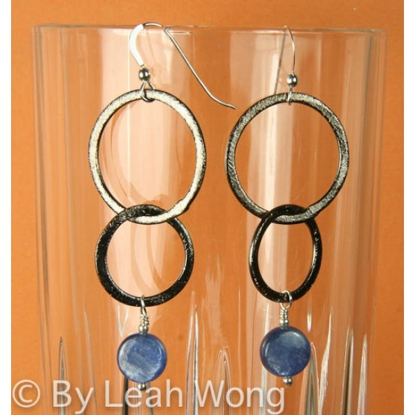 These earring are make with a sterling silver french hook followed by oxidized, brushed copper and finally a drop of blue kyanite. $25.00