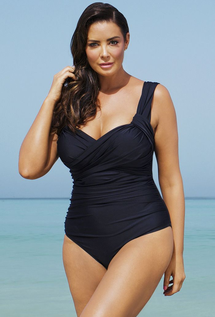 """Enter to win your swimsuit  Tropiculture Black Crossover Swimsuit       Signature PowerMesh tummy-control lining instantly slims     Sweetheart neck     Soft molded cup bra    Tropiculture Black Crossover Swimsuit  http://www.planetgoldilocks.com/swimwear2.htm  #Plussizeswimwear  #plussizewsimsuits    Non-adjustable, wide straps offer full bust support     Ruched bodice     Side seam measures 14"""" from Underarm to Hem     Sizes 8-16 fit up to a C/D cup; sizes 18-34 fit up to a D/DD cup"""
