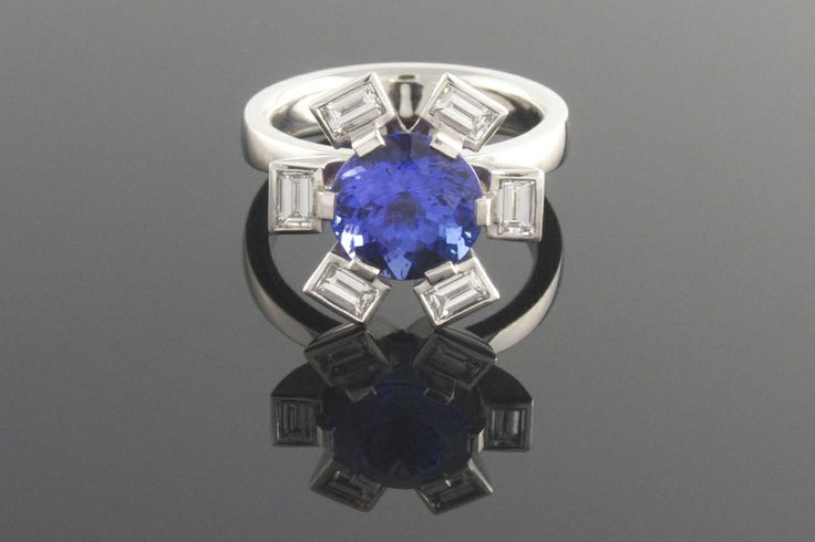 Platinum 6 claw tanzanite and diamond dress ring - A six claw platinum dress ring with emerald cut diamonds bezel set in the surround and claw set tanzanite centre stone | Eva Dorney Goldsmith