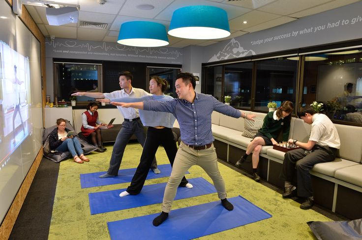 Talent 100 Founder, Richard Chua using the yoga facilities with Talent 100 students.