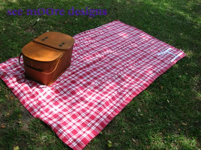 Picnic blanket. Maybe not this colour scheme but one that rolls up and gas water proof bottom