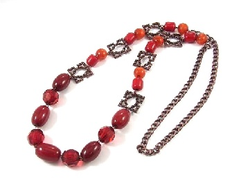 Bronze colored, red beaded, long necklace. 53cm in length