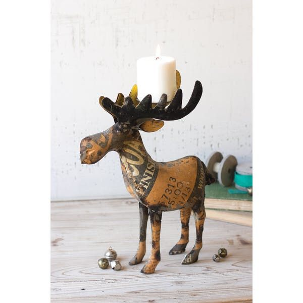 Kalalou Recycled Metal Moose Candleholder. Made out of recycled metal, this rustic candle holder features an authentic reclaimed metal texture that will always vary. This moose is a unique alternative to traditional candle holders and ideal for those looking for a pop of vintage flair in their décor.