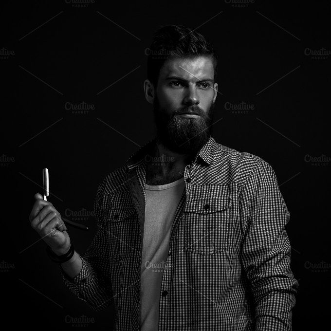 Bearded man with straight razor by Usmanov Stock Photography on @creativemarket