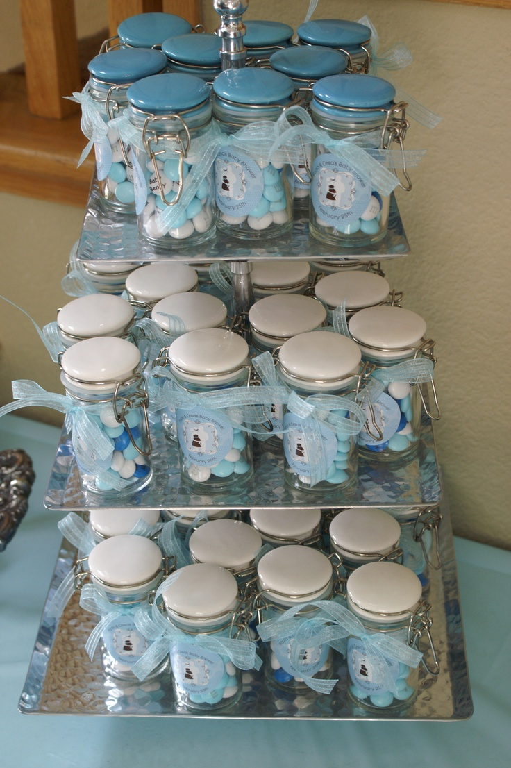 Favors for my cousin's baby shower, personalized white and blue M&Ms in spice jars.