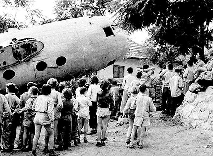 DOUGLAS DC-5 IN AUSTRALIA These three remarkable photographs record the fuselage of the world's last DC-5 being transported to Givat Benner kibbutz,    for a children's playground.