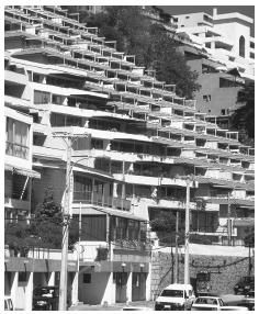 Chile's mountainous regions force architects to be creative, as these apartments built into a hillside in Renaca show.