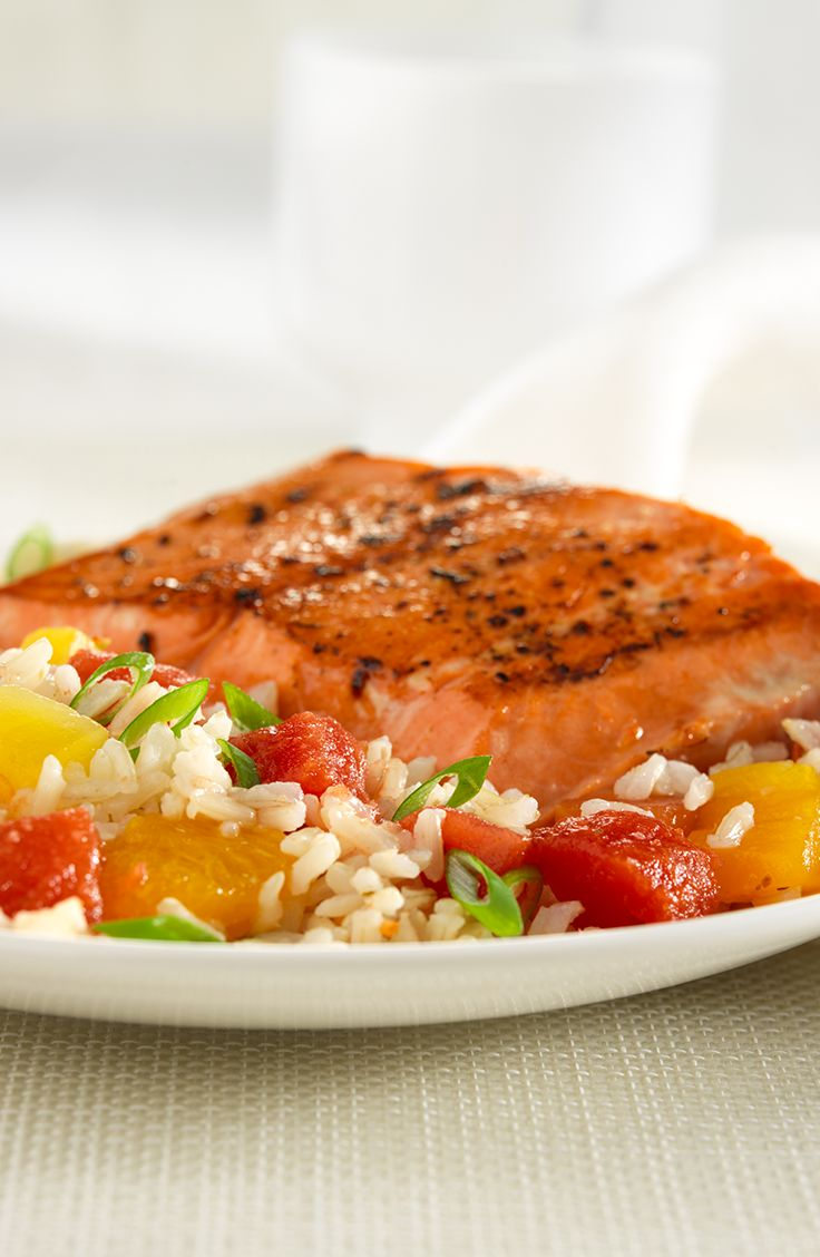 Spice up your plate with delicious Spicy Salmon with Tropical Salsa Rice.