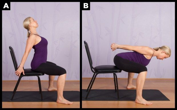 Chair modified wide legged camel yoga pose.