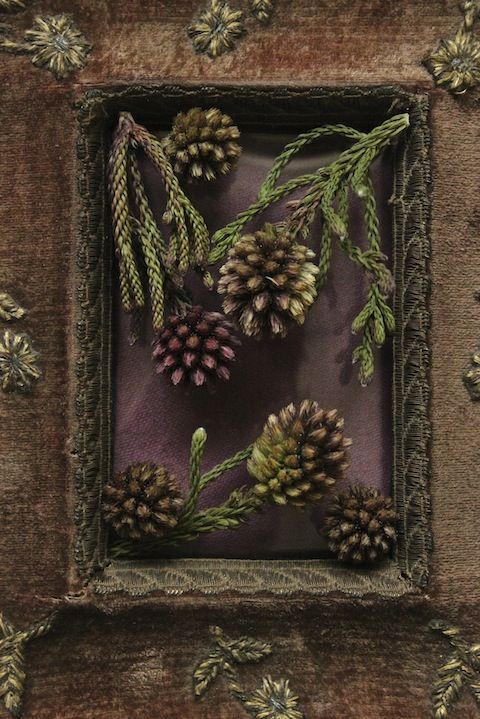 Old fabric picture frame with added foliage
