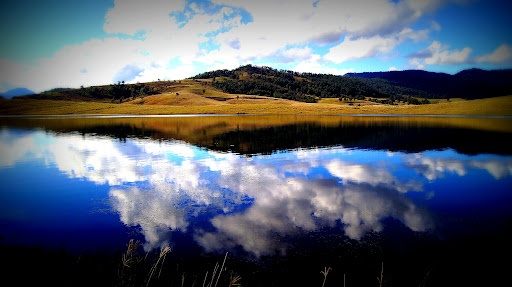 Mirror Lake by Carleen Corrie - Landscape and clouds reflected in lake Click on the image to enlarge.