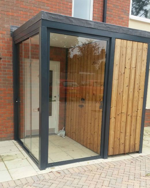 This glass room installation created a practical porch area to reduce the chill/wind factor when our clients opened their front door. This installation of a glass room porch was exactly what our clients wanted to reduce the amount of heat lost whenever the front door was opened. Now they have a lovely light