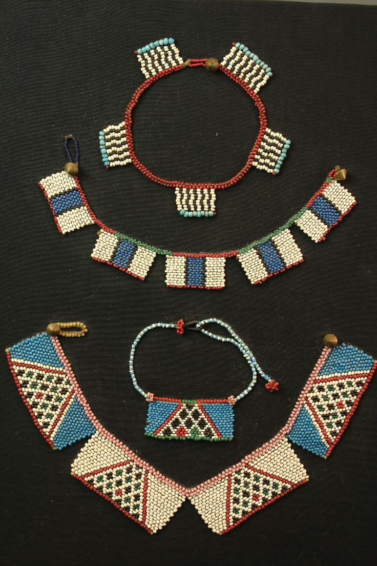 A fine set of four mounted pieces of early Zulu bead work.Pre 1930′s