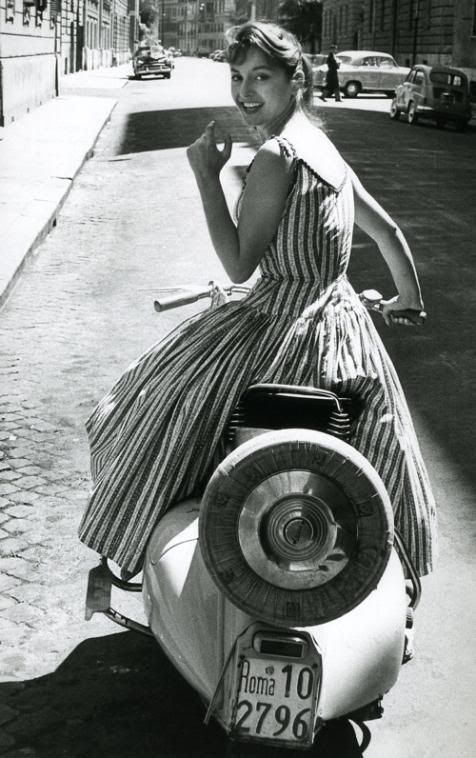 1950's girl on a Vespa                                                                                                                                                                                 More