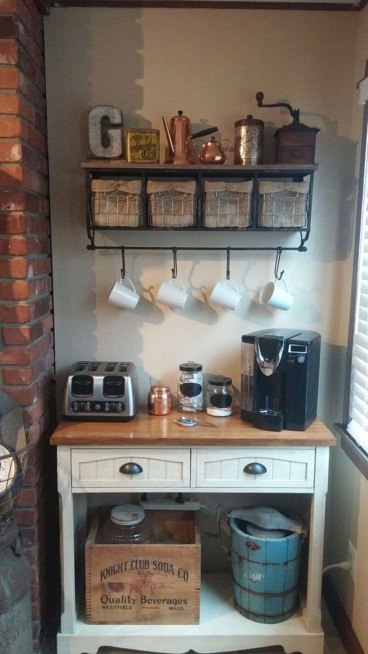 Coffee bar, hobby lobby shelf, I made a burlap liner for the wire baskets to hide k cups. Antique tea and coffee tins and grinder, copper kettle, creamer and jam jar. Antique icecream maker and local soda crate.