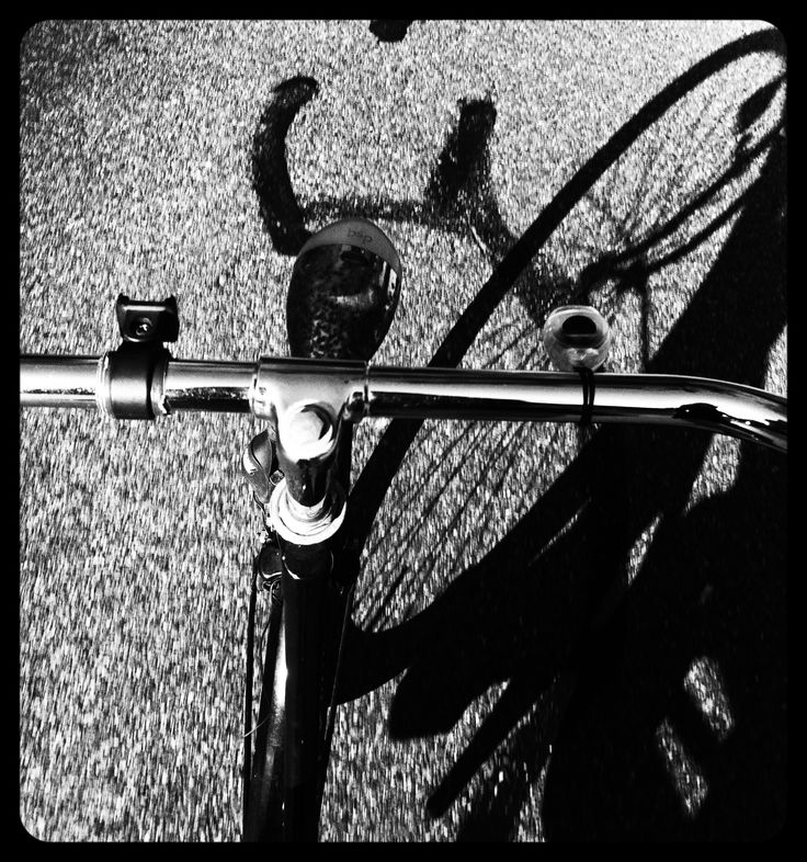 Cycle shadow. On the road in Hilversum, October 2013. The Netherlands. Bike.
