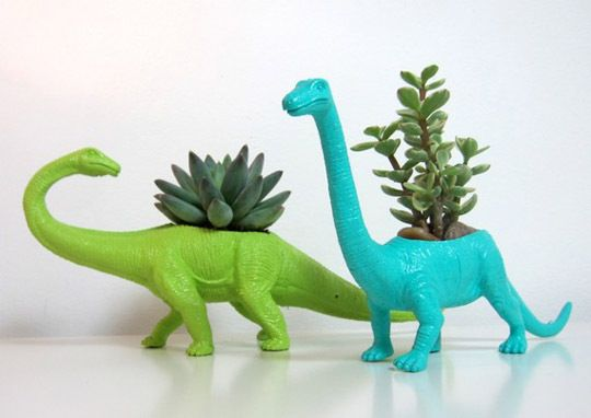 Upcycle plastic dinosaurs to succulent planters. Originally sold on Etsy for $18, they seem to be gone now. Should be possible to DIY!