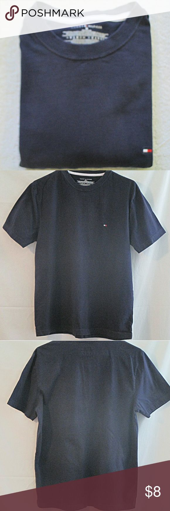 """Tommy Hilfiger Navy Blue Polo Shirt  M Here's a nice looking navy blue , short sleeve shirt that is in good condition with only gentle wear. Stated size is medium. Measurements are 18"""" shoulders, 21"""" chest, 9"""" cuffs, 21"""" tail, 26"""" length. All measurements are taken with the garment laying flat. Tommy Hilfiger Shirts Polos"""