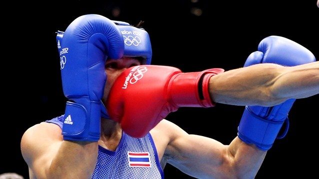 Kaeo Pongprayoon of Thailand in action with Mohamed Flissi of Algeria during the men's Light Fly Boxing on Day 4 of the Games.