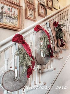 Hobby Lobby Metal Letter dressed up with ribbon and pine sprigs and hung on the stairs. Cute Christmas decorating idea!